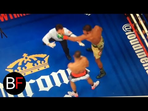 Boxing referee gets punched after the round!