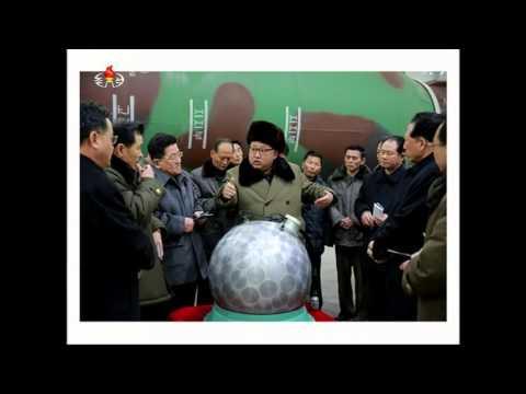 Kim Jong Un looking at nuclear warheads