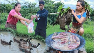 Women with rabbits found duck to cook at river and eat with a women - Eating delicious
