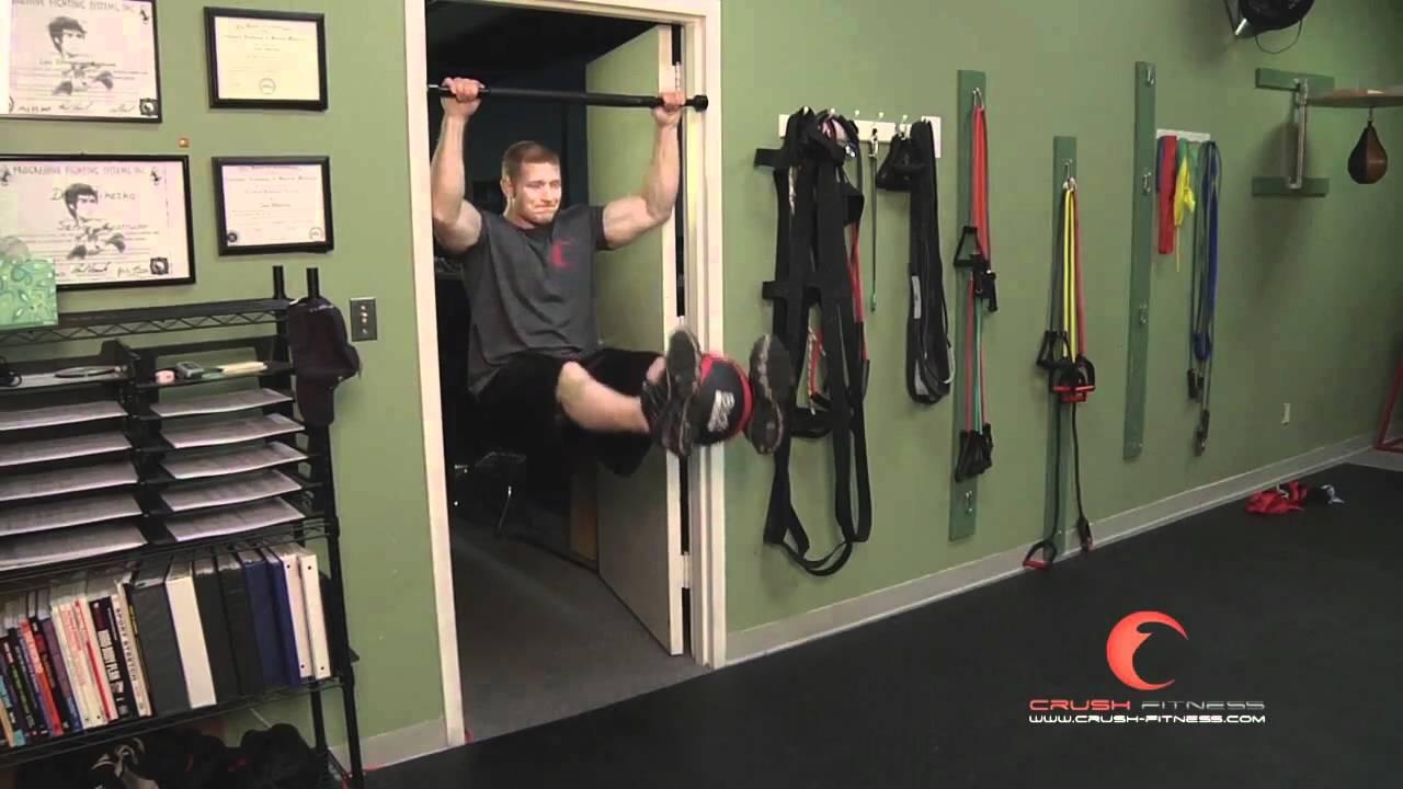 Hanging knee raises with medicine ball - Core Hanging Leg Raise With Medicine Ball