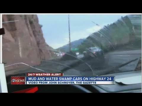 Mud and water swamp cars on HIghway 24