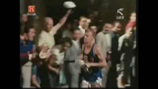 Abebe Bikila wins marathon in 1960 Rome Olympics... barefoot.