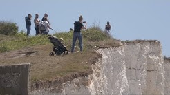 Keep back! Visitors with toddlers dice with death to take selfies on CLIFF edges