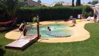 Piscine lagon en gomme caoutchouc - Combien coute une piscine naturelle ...