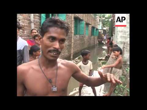 Floodwater spreads industrial waste through Dhaka's shantytowns