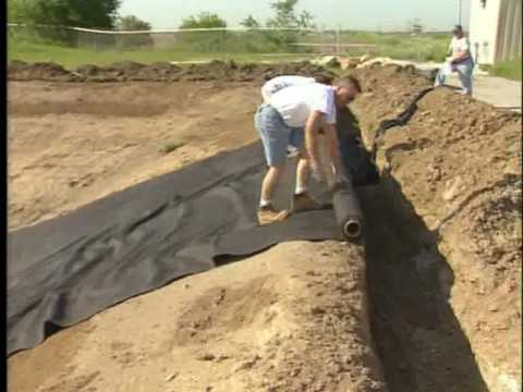Install geotextile- up hill.avi