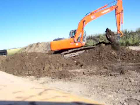 Digger Moving Dirt Piles - Excavation Station
