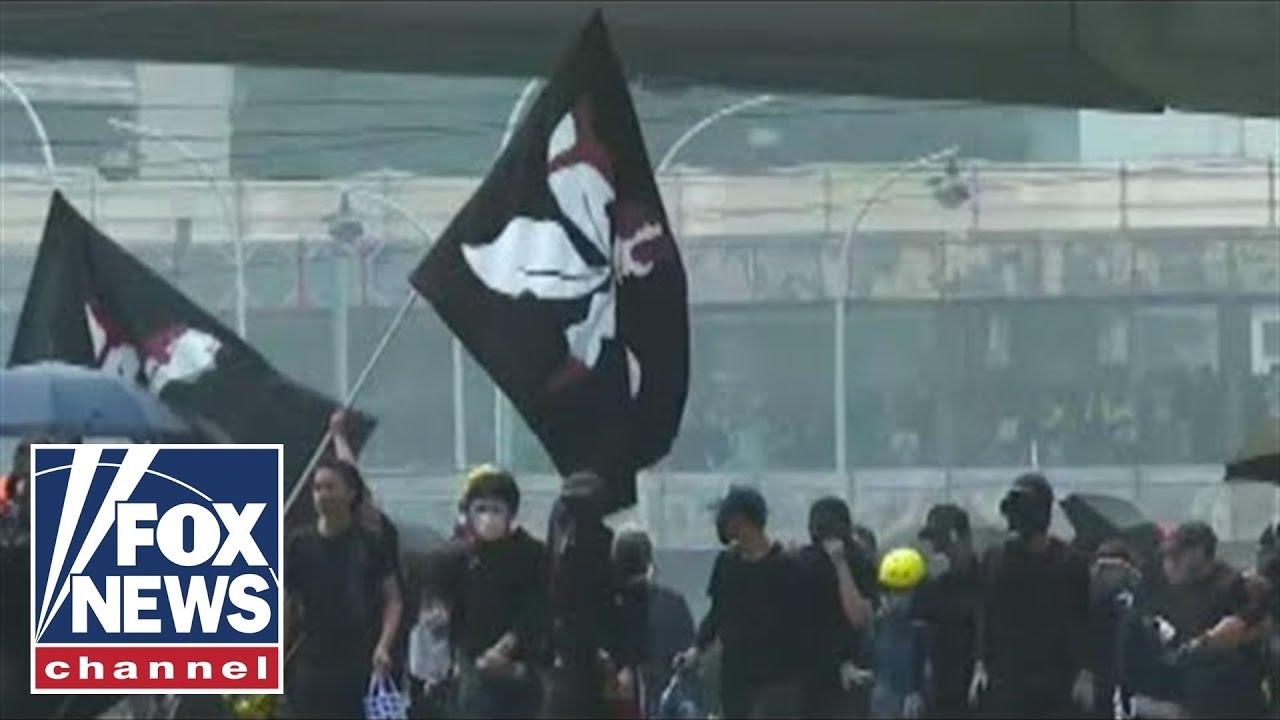 Thirteen injured in Hong Kong protests: Report