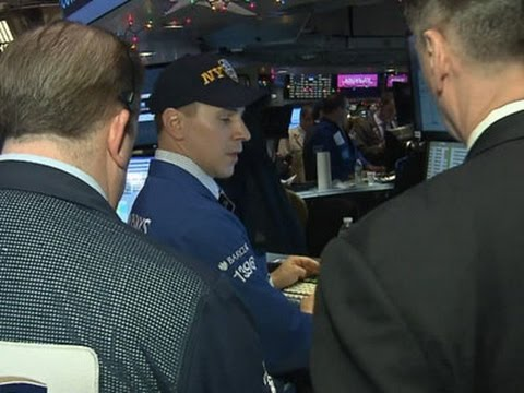 Strong Economic Data Pushes Dow Above 18,000