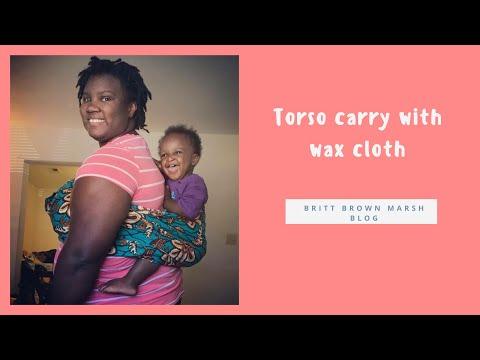 Torso carry with Nigerian wax cloth