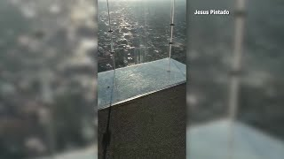 DON'T LOOK DOWN: Sky-deck at Chicago's famed Willis Tower cracks while family's on it