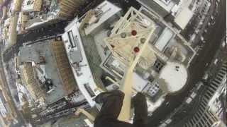 Walking the spiral stairs on skyscraper's roof