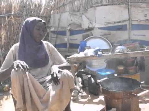 Women cooking with the Berkeley-Darfur Stove