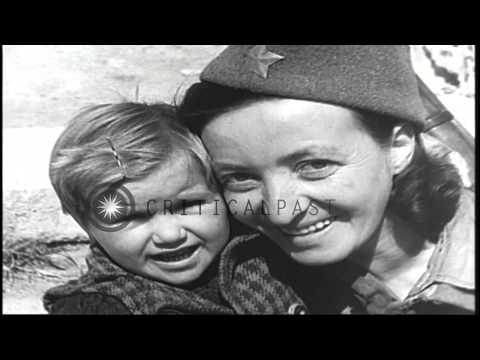 The Yugoslav Partisans with children in Yugoslavia during World War II. HD Stock Footage