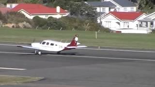 Golden Bay Air ZK ZIG, Air NZ Beech 1900D ZK EAB taking off form Wellington