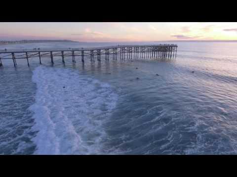 surfing Pacific Beach pier