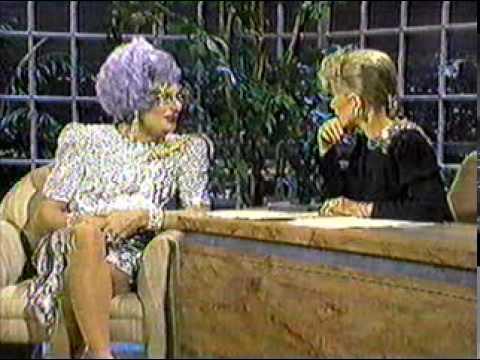 Dame Edna wearing silver dress (part 1) on Joan Rivers talk show