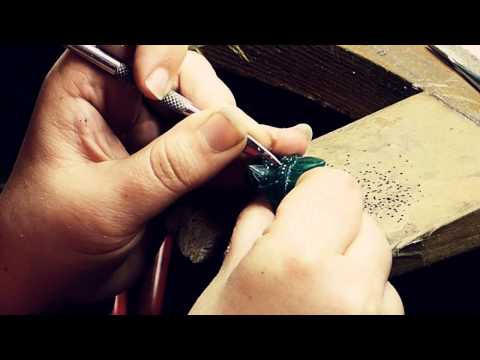 Creating a silver ring by carving a wax by hand