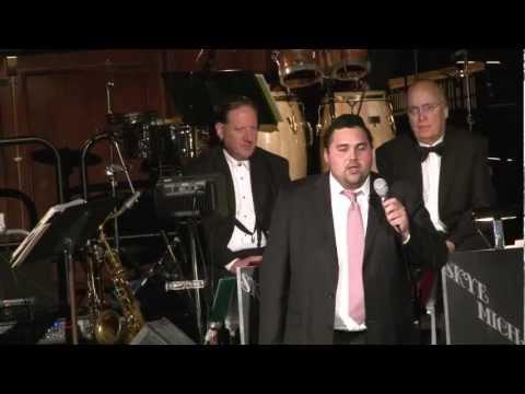 Rabbi Moshe Samuels on piano, Isaac Mizrahi singing