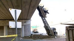 Dump truck crashes through side of overpass in B.C.