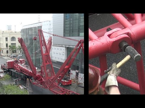Assembling a large mobile crane that will be used to disassemble a tower crane