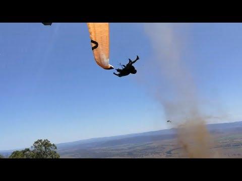 Dust devil sends paraglider flying