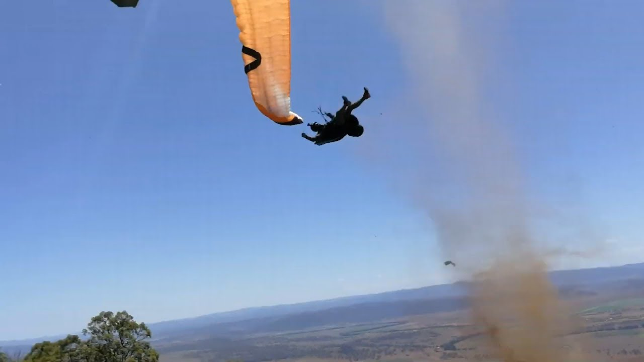 Terrifying video shows paraglider picked up by dust devil
