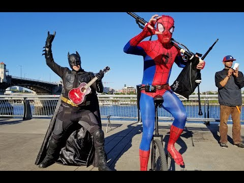 Ukulele Batman Returns to Battle Unicycle Bagpipe Spider-Man in a Theme Song Throw Down!