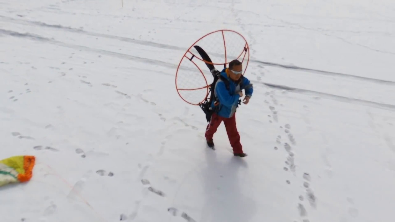 Minne motor the electric paramotor flying over frozen lake