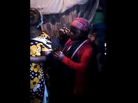 Sisters from the Kibera Slum Praying for Clothes Made by Living Faith Christian Fellowship 9 2 2018