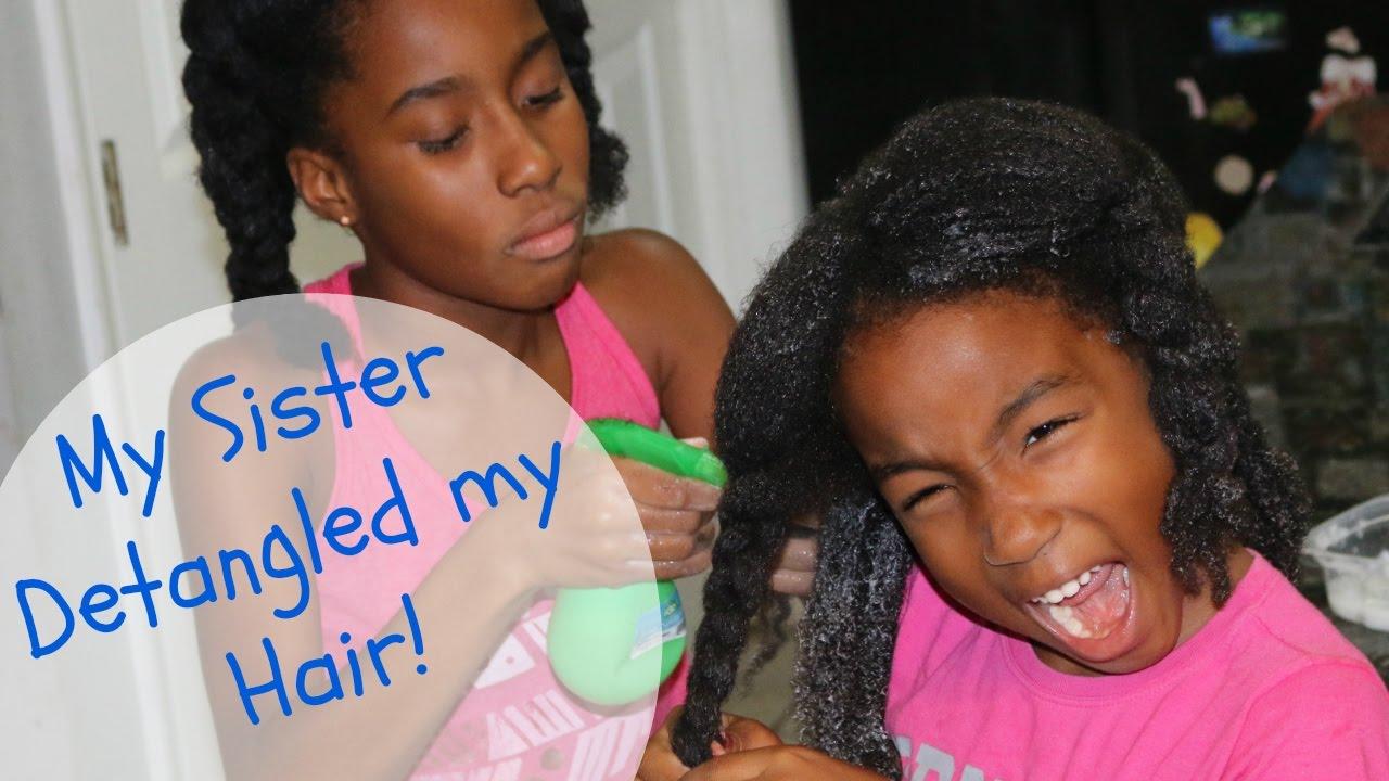 11 year old girl detangles her sister's hair like a pro!