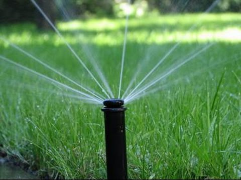 Pop Up Sprinkler System For The Lawn Showing The