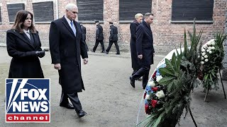 Vice President Mike Pence lays wreath at Auschwitz memorial