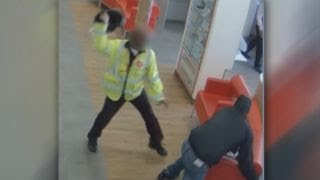 Watch security guard attack robber with helmet