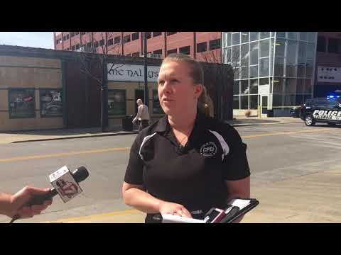 CPD Public Information Officer Bryana Larimer briefs on downtown suicide