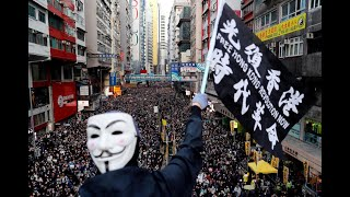 Police raids ahead of rally to mark 6-month anniversary of Hong Kong protest movement