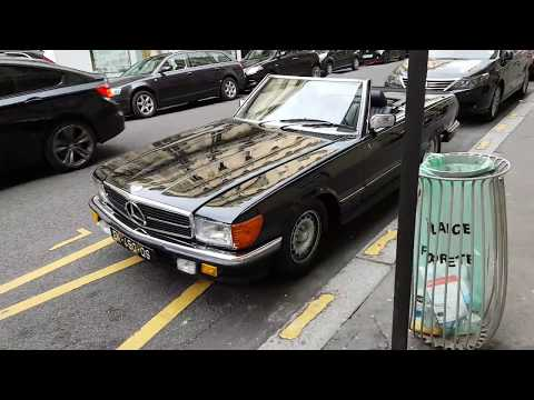 black MERCEDES AMG  500 SL (R107) convertible in paris france