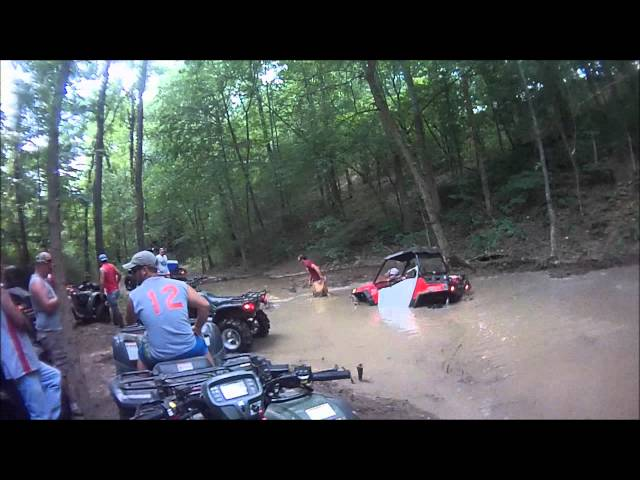 Polaris RZR Side-by-Side (SxS) and several ATV's playing in the mud pits at Sandtown Ranch Travel Video