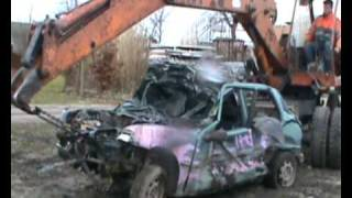 Peugeot 106 crushed by old Atlas excavator