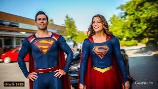 Супермен и Супергёрл помогают жителям города