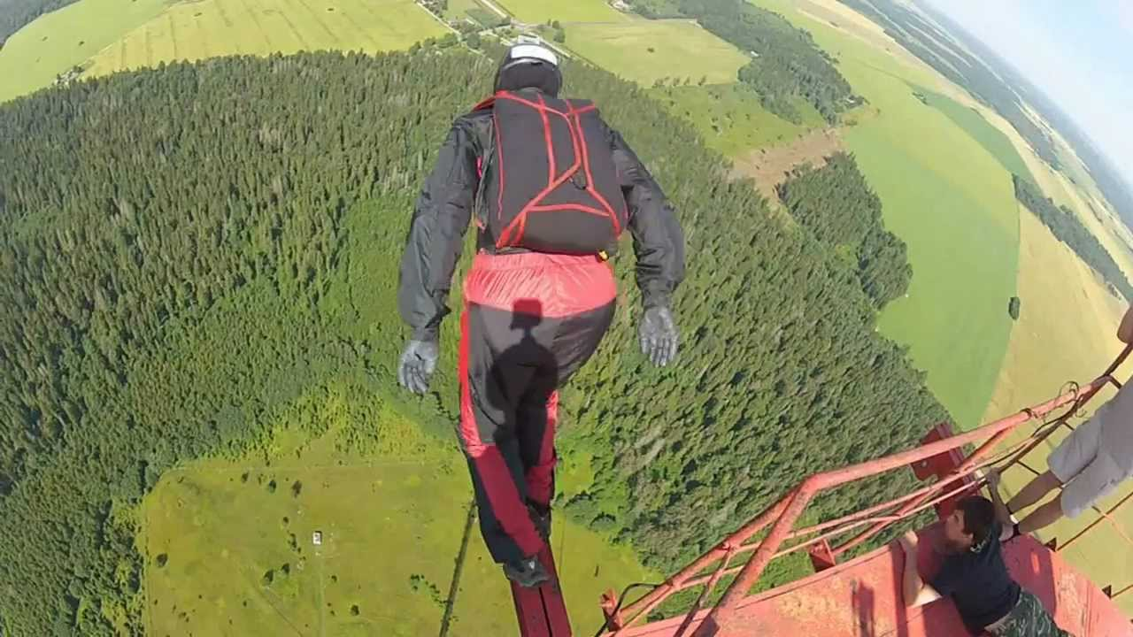 Base Jumps From Very High Antenna Tower YouTube - Crazy guy base jumps radio tower