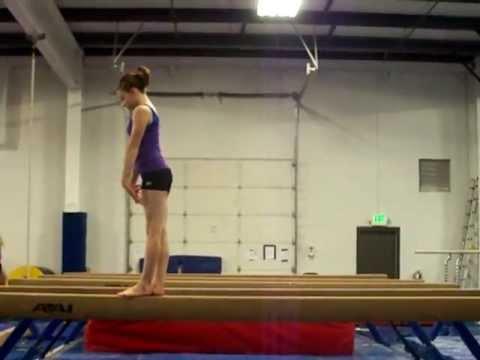 Gymnastics Back Handspring On High Beam