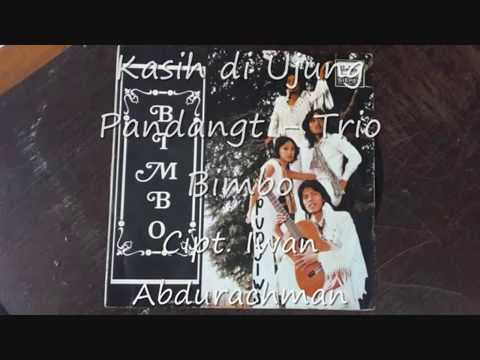 Free Download Kasih Di Ujung Pandang (  Iwan Abdurachman ) - Trio Bimbo Mp3 dan Mp4