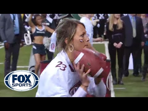 Girl wins $100,000 throwing football with two hands