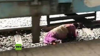 Anciana se salva de morir atropellada por un tren en India