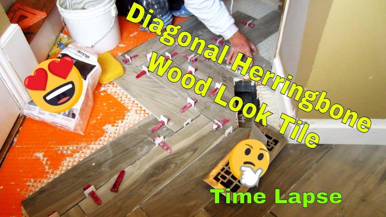 Herringbone wood look plank porcelain tile floor time
