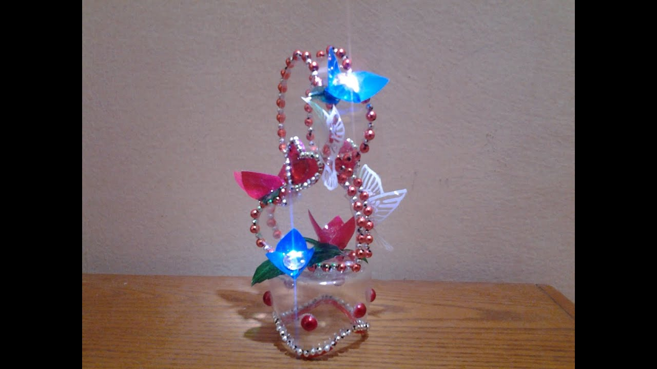 Best out of waste plastic bottle transformed to lovely for Waste material things for decoration