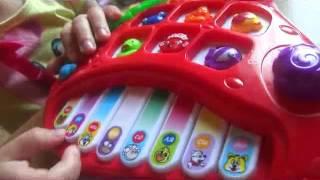 Обзор развивающих игрушек   машинка  телефон, конструктор цветочки и детское пианино