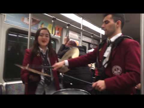 Harvard Crimson Marching Band plays on the subway