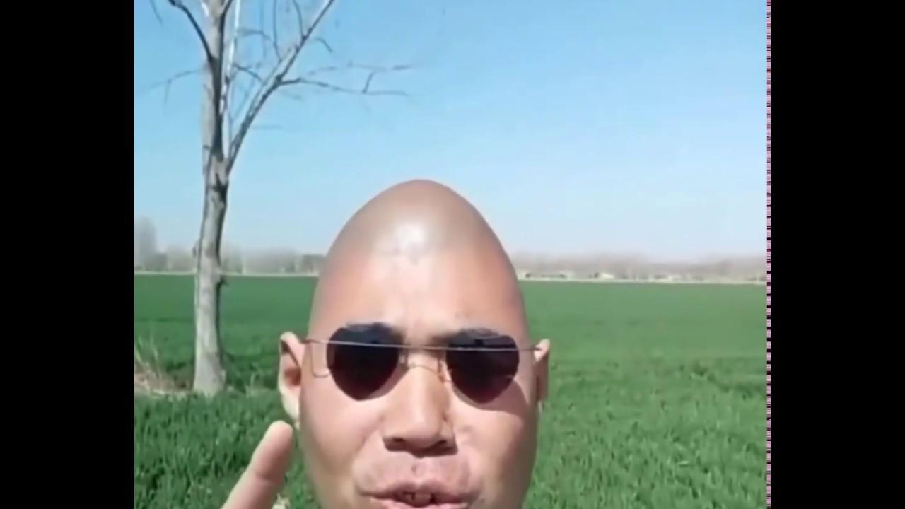 Asian man singing in a green field